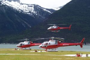 Helicopters heading for a glacier